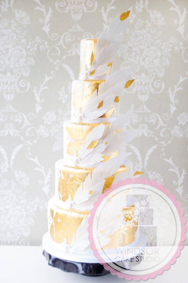 5 tier wedding cake with gold leaf, wafer paper feathers, and gold ...