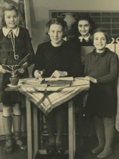 Anne Frank with her teacher and two fellow students at the 6th Montessori School in Amsterdam
