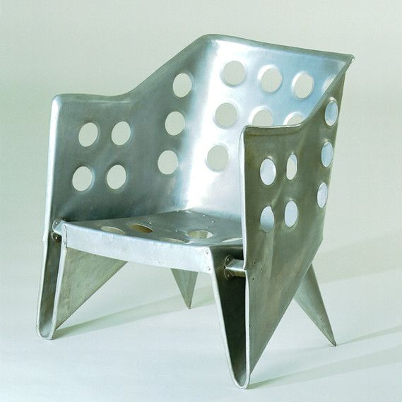 Designer: Gerrit Thomas Rietveld |  Piece: Aluminum Armchair (chair) | Design: 1942  Production: 1942  Manufacturer: Gerard van de Groenekan  and Wim Rietvelt, Utrecht  Size: 71 x 70 x 65; seat height 33 cms  Material: sheet aluminum