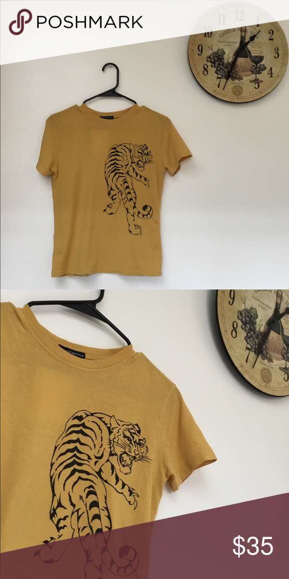 40deb697510d8 Brandy Melville yellow tiger graphic T-shirt new Brand new best fits ...