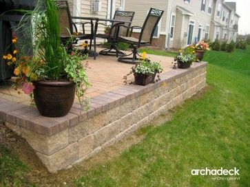 Deck Cantilevered Over Slope Retaining Wall Belgard Paver Patio With Retaining Wall In Aurora Concrete Paver Patio Landscaping Retaining Walls Patio Stones