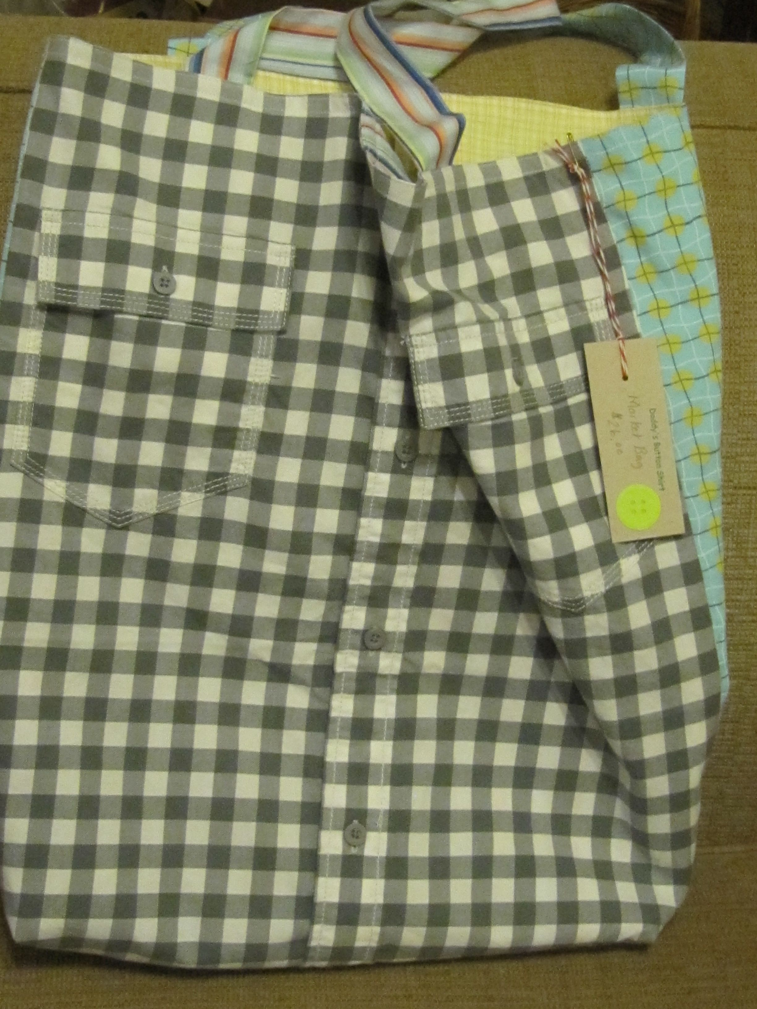 Market Bag - Gray/white check with yellow/gray/turquoise print reverses to yellow check with blue/turquoise/pink stripe $26 Daddy's Button Shirt - sold big Bang Bazaar