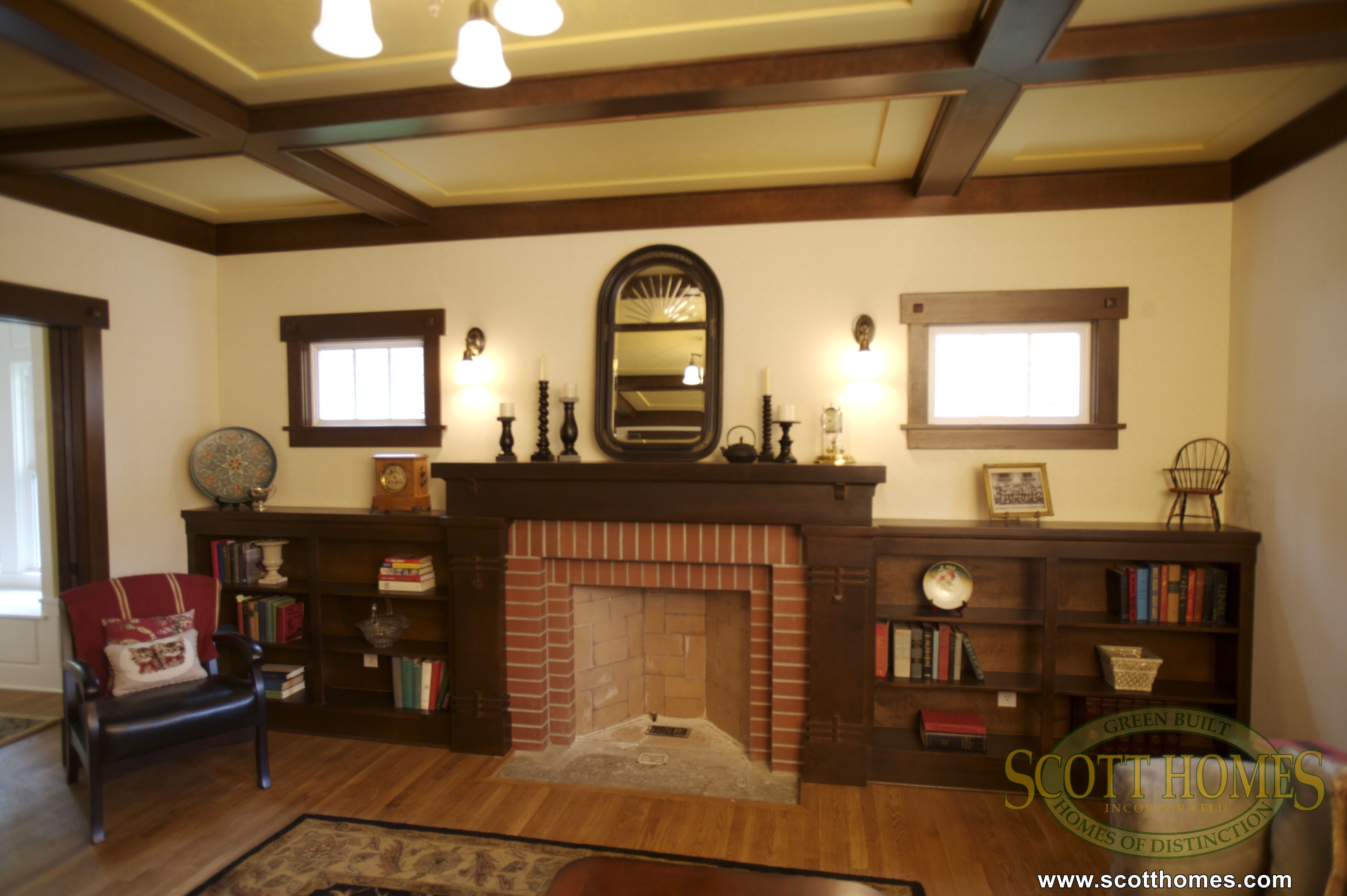 This cozy living room, has a fireplace, lots of built in ...
