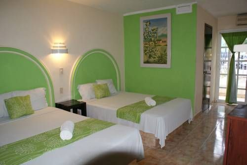 Hotel HC Internacional Cancún Set in central Cancun, only 14 minutes' drive from the hotel area and 25 minutes' drive from popular La Isla Shopping Centre, the family-oriented and eco-friendly Hotel HC offers free Wi-Fi access and a solarium.