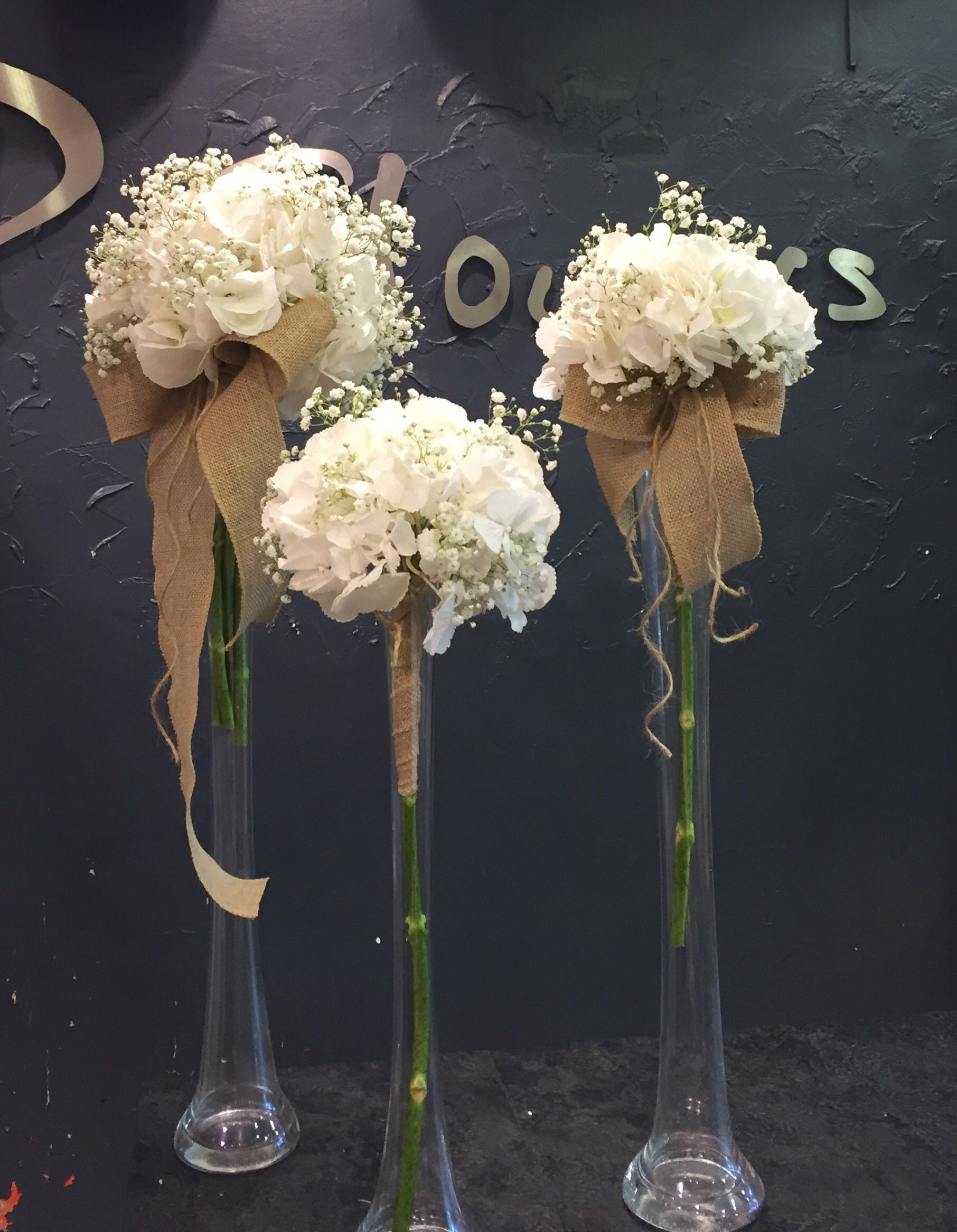 Pure white bouquets with gypsophila and white hydrangea