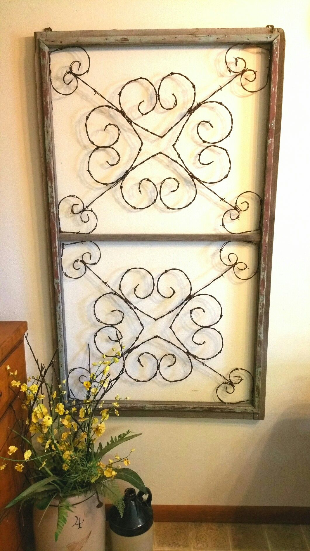 Old wooden window frames with barbed wire artwork made from upcycled ...