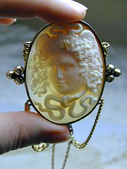 "Victorian Medusa bracelet, circa 1860s. Milk and honey colors. Gold setting. 2 1/8"" x 1 5/8""."