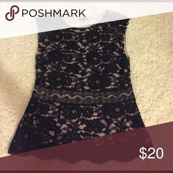 The limited lace peplum top Worn once. No flaws. Tops Tank Tops
