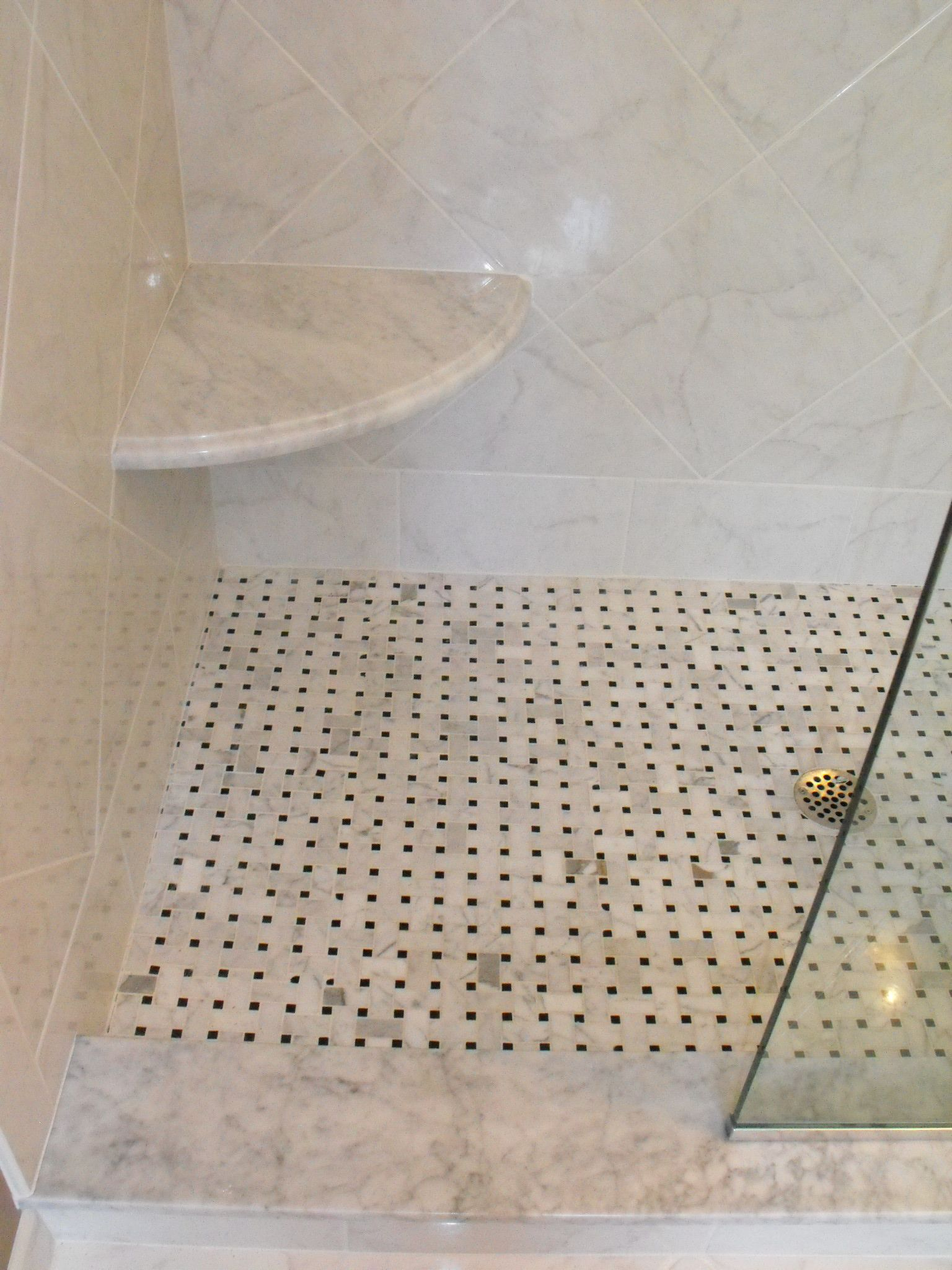 carrarra and nero basketweave marble shower floor carrarra marble shower seat with ogee edge