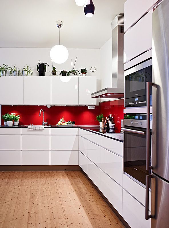 Black White Silver Kitchen Ideas Part - 26: Red Splashback White Cabinets Silver Appliances And Wooden Floor. Black  White Silver Kitchen Ideas » ...