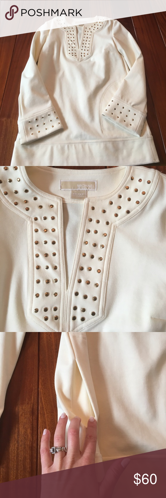 Michael Kors tunic BNWOT Michael Kors cream with gold hardware tunic. Has pockets and bell sleeves with gold hardware repeated like v-neckline Michael Kors Tops Tunics
