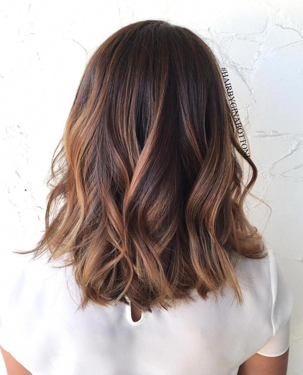 60 Chocolate Brown Hair Color Ideas for Brunettes #40: Cropped Chocolate Brown Hair For a gorgeous take on the balayage trend that doesn\u2019t feel too prissy, go for a cute choppy bob. Add some randomly placed honey highlights to update your natural dark hair color. This cut is girly and tons of fun. Imperfect curls only add to the allure. #brownhaircolors