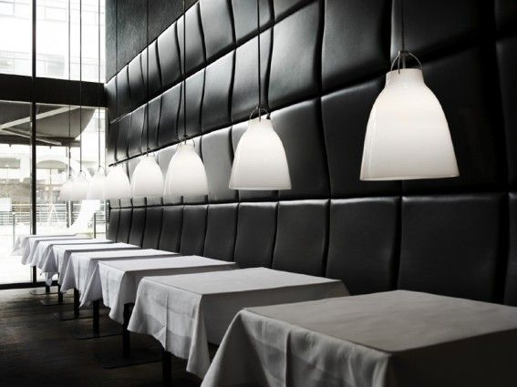 Caravaggio lighting pendants designed by Cecilie Manz. Opal - a white hand-blown glass.