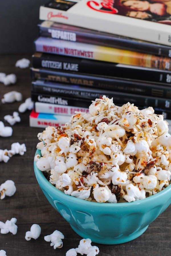 Pizza Popcorn - Start with a big bowl of popped popcorn, then whip up a quick pizza-flavored olive oil that includes sun-dried tomatoes, Parmesan cheese, and lots of Italian herbs. | foxeslovelemons.com