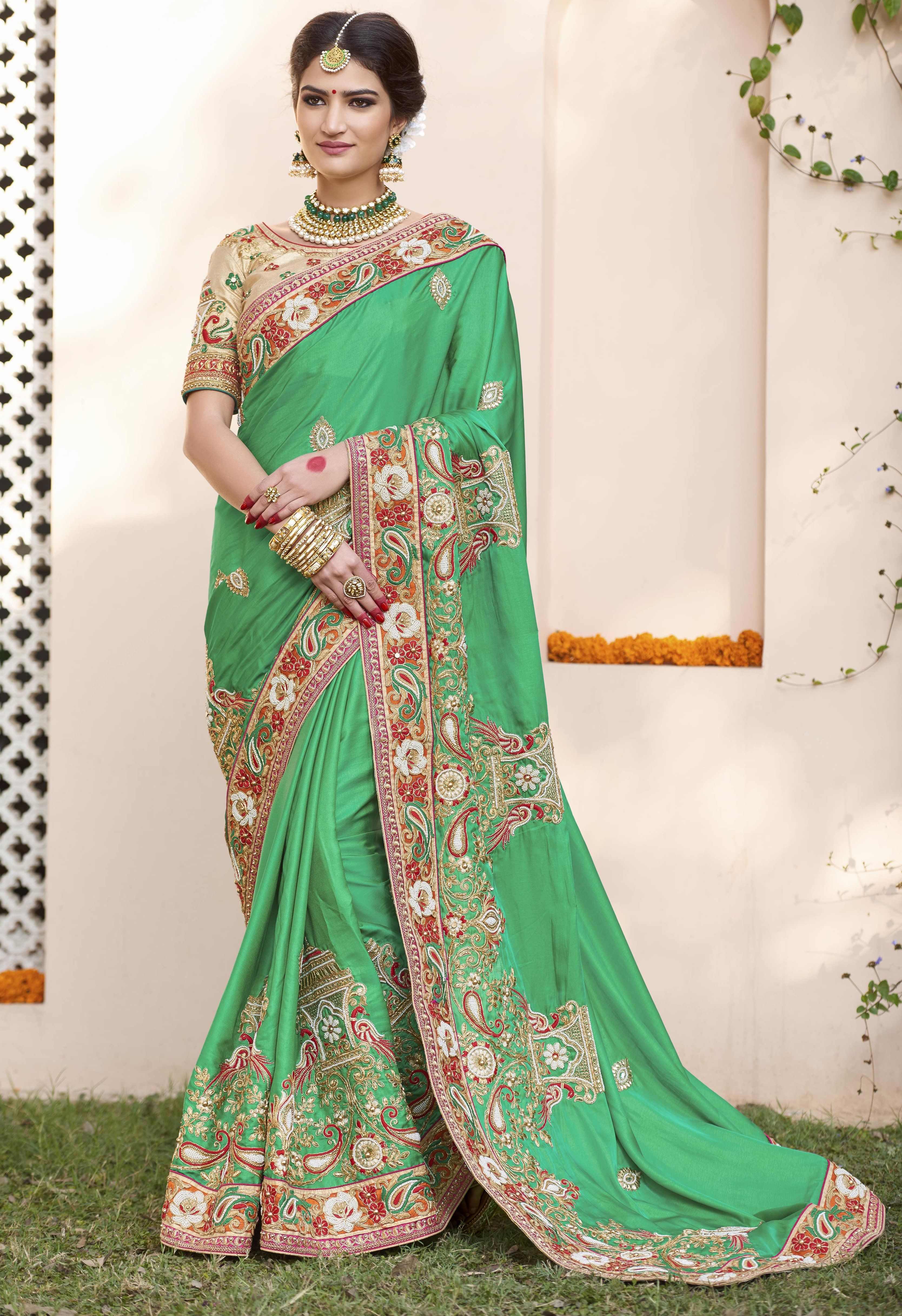 Green Zari Embroidered, Moti Work, Thread EmbroideredFaux Georgettesaree Category : Saree Saree Fabric : Faux Georgette Blouse Fabric : Raw Silk Work : Zari Embroidered, Moti Work, Thread Embroidered Color : Green Size :6.3(5.5 Saree 0.8 blouse ) Style : Wedding saree Remark : Dry clean only