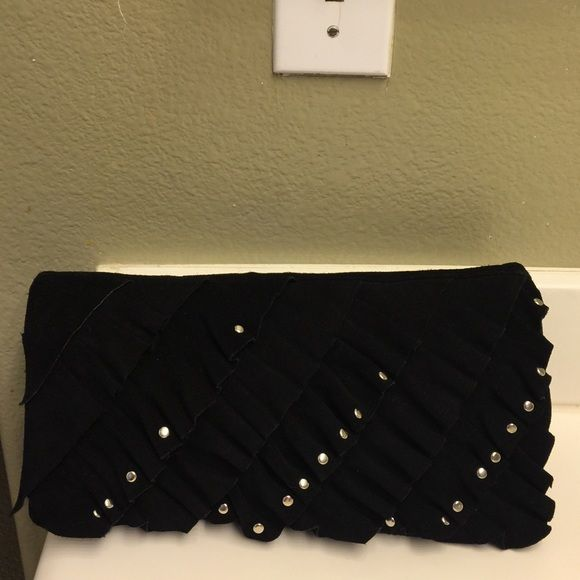 Black suede leather clutch Sturdy feel , Gently used , super clean inside and out , 12x6.5  has silver studs through out front Sorpresa Bags Clutches & Wristlets