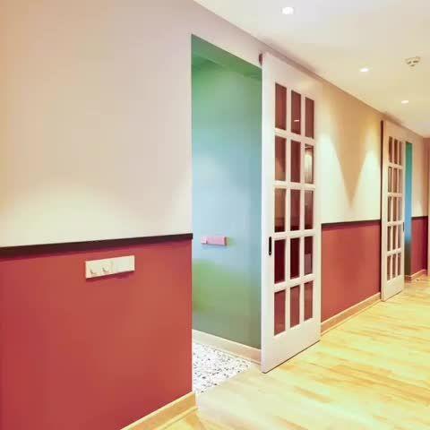 Photo of Современная раздвижная дверь вдоль стены. С…