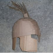 Spartan helmets were worn by the Spartan warriors to protect them from a foe's savage blows and to intimidate their enemies. You can make a cardboard replica of a Spartan helmet so your child can re-enact famous battles or to add to your costume for a party.