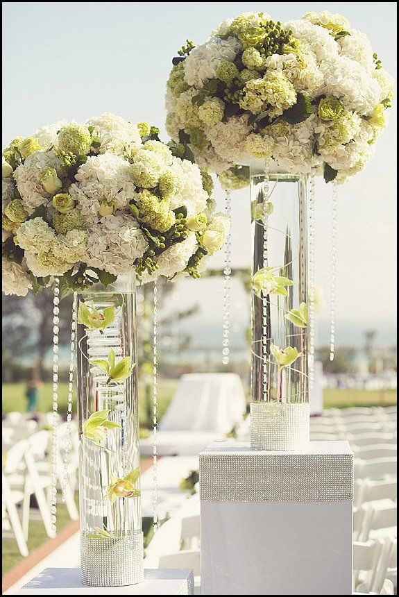 wedding ceremony flowers- love the clear vaca and crystals- diff color flowers