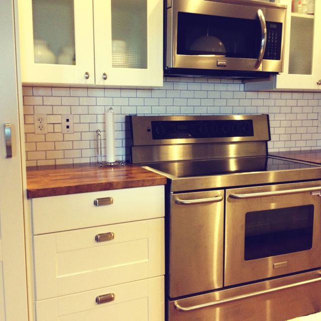 Best Backsplash For Butcher Block Countertops : 2x4 white subway tile backsplash, cup drawer pulls, butcher block countertops, stainless steel ...