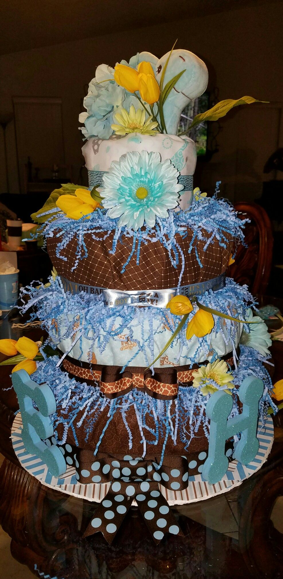 Baby boy diaper cake.  Chocolate brown and baby blue. Giraffe and flowers. By J. Lacourse