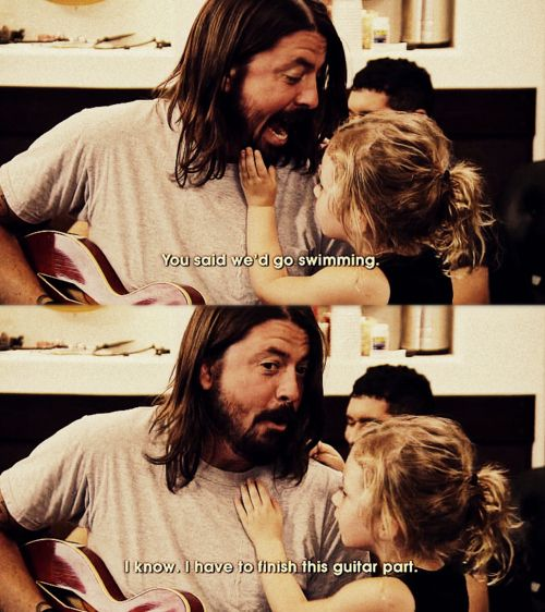 I adore Dave Grohl....this is from the documentary about the making of their new album.  He finished his guitar part and went swimming. <3  Came back with wet hair and played some more music