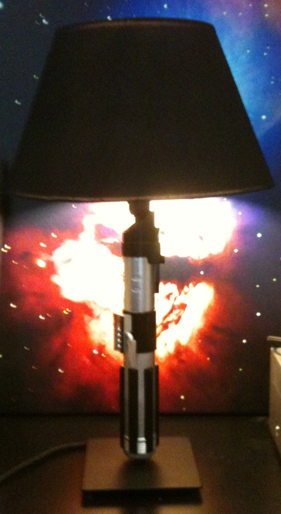 Do it yourself light saber lamp using an IKEA lamp and only costing around $20. This is awesome.