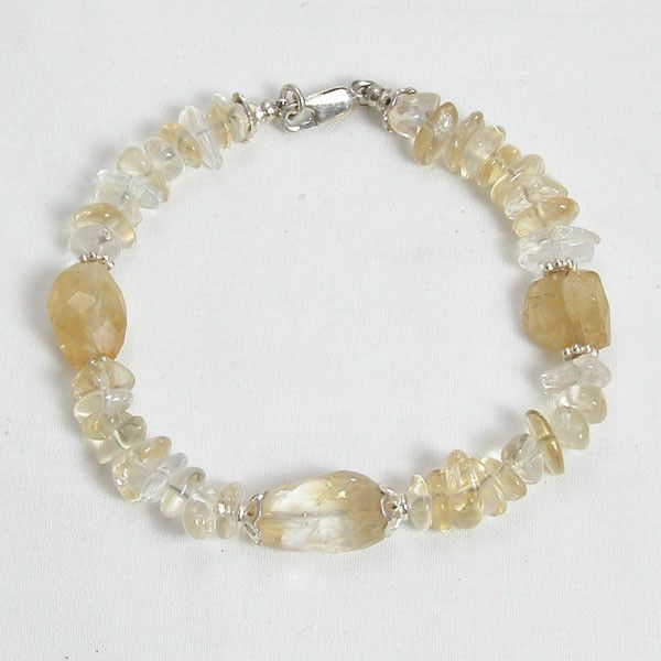 "Handmade gemstone citrine bracelet features a strand of semi-precious citrine gemstone nuggets and chips, sterling silver accent beads, wire band, and lobster claw clasp. 8"" in length. Add a necklace,"