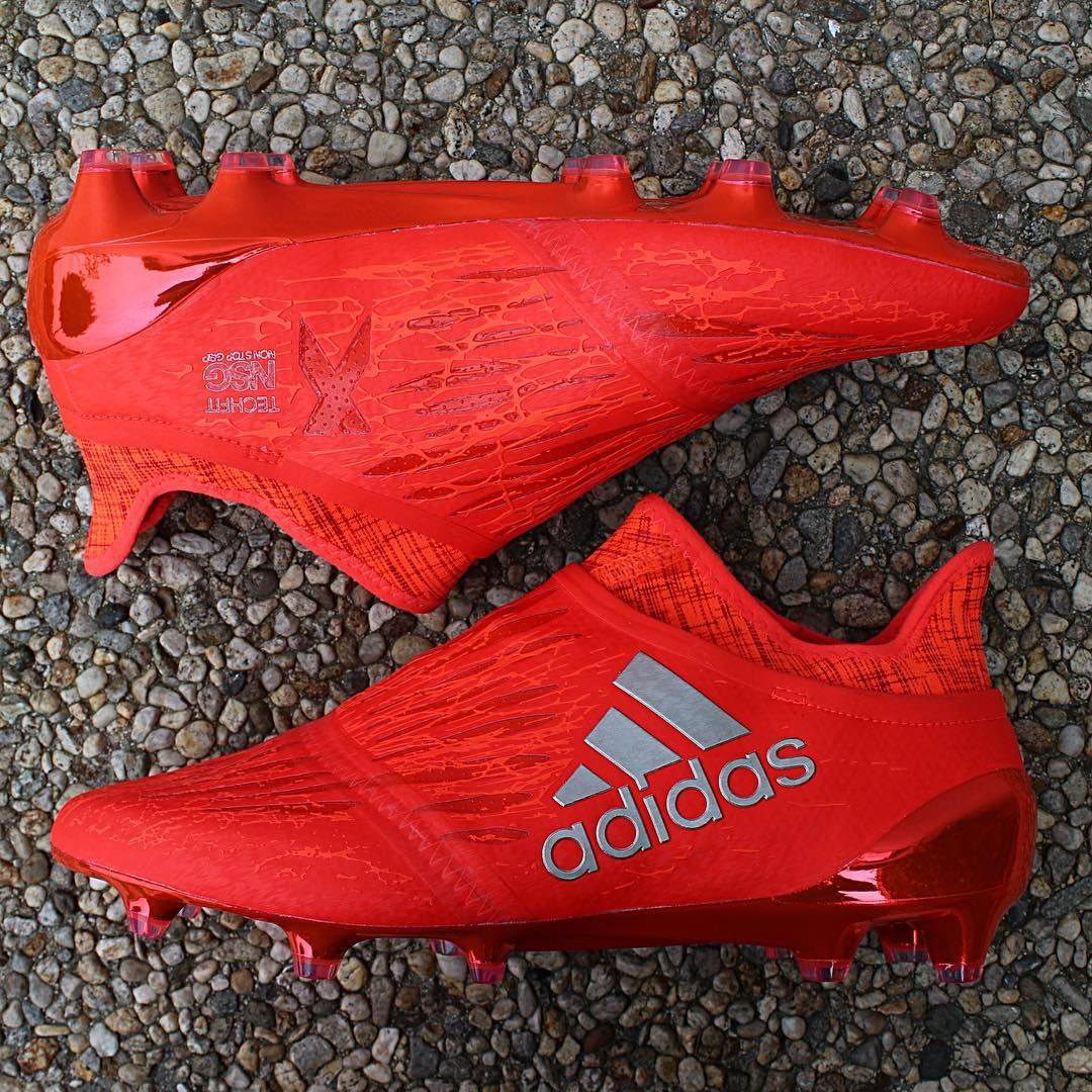 the red adidas x purechaos boot features a ultra stylish design.