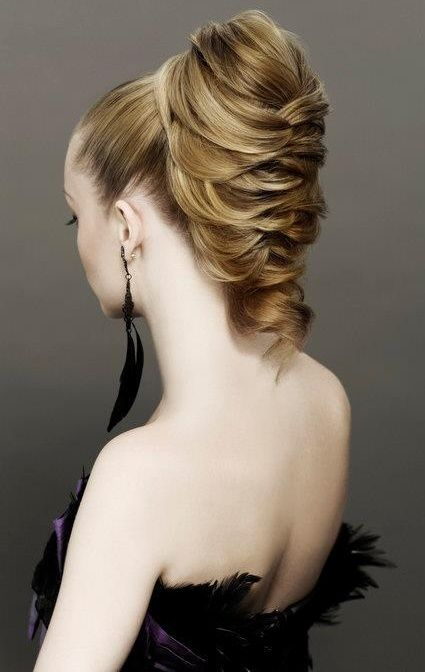 Loose braided and woven updo style with super sleek ponytail base