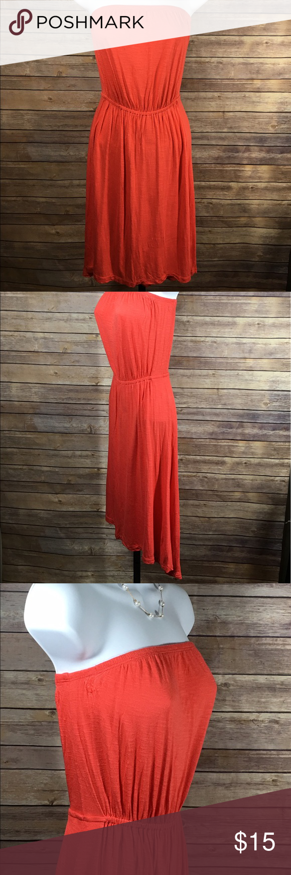 Old Navy Orange Maxi Hi Lo Strapless Dress Size XS Old Navy Womens Maxi Hi Lo Asymmetrical Strapless Sleeveless Dress  Elastic around the Top of Dress for Better Hold Color:  Orange Size:  XS Approximate Top Center to Bottom Hem Measurements:  33 inches Approximate Arm to Arm Measurements:  15 inches Made in Vietnam Excellent Used Condition Old Navy Dresses Asymmetrical