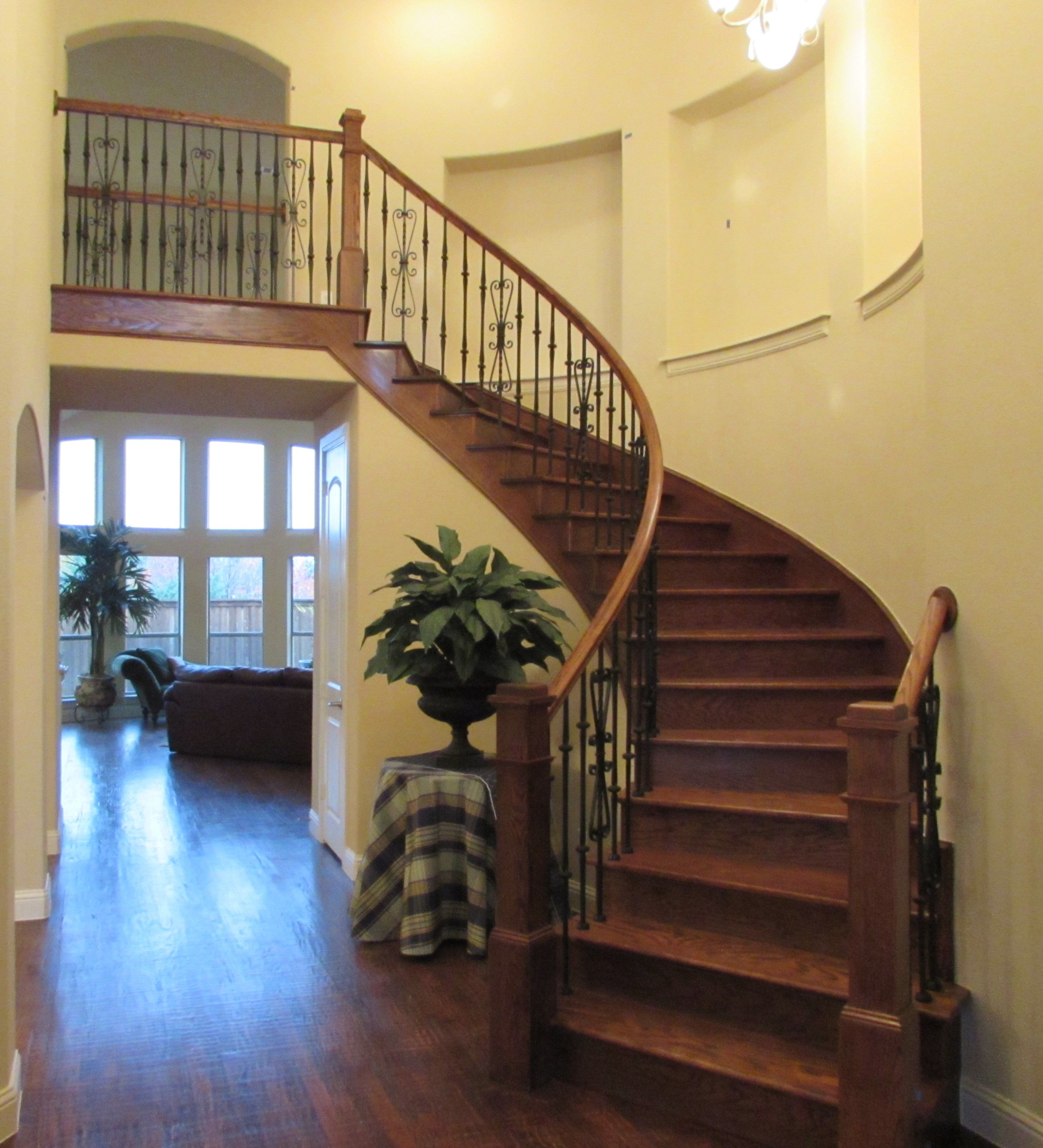 Wrought Iron Staircase: Dramatic Curved Staircase With Wrought Iron Balusters