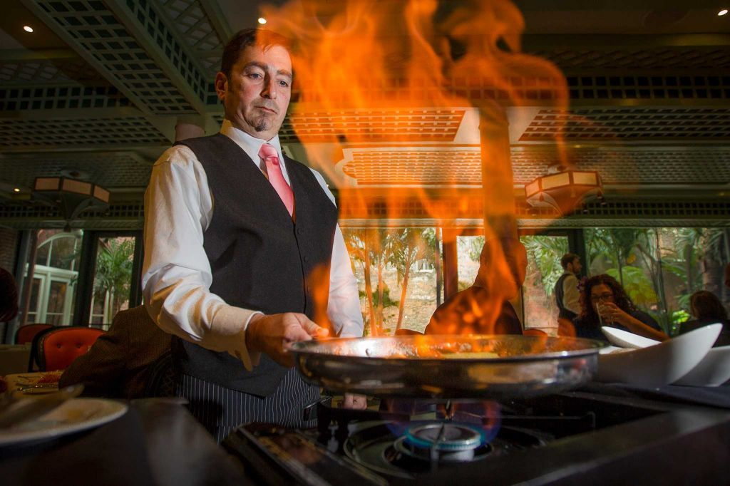 Etienne DeFelice makes a bananas foster on opening day at