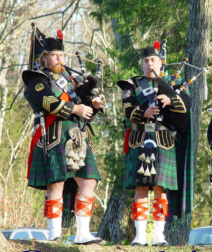 Pipe Major and Sergeant Performing traditional Scottish music of highland bagpiping and drumming along with proper highland attire.