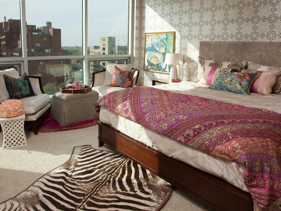 The antique sari, zebra rug and patterned wallpaper give this bedroom an exotic vibe.