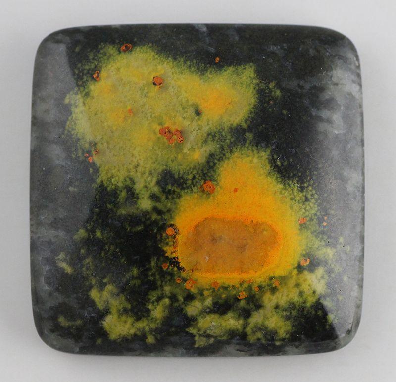 Eclipse Stone from Indonesia. Yellow-orange Orpiment in black Quartzite.