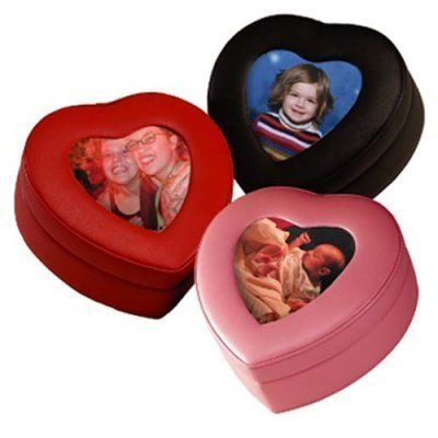 Sweetheart Framed Everything Box - 6W x 2.5H in. by Emporium Leather Co Inc. $61.99. Fantastic for the most special of keepsakes or jewelry items this heart-shaped box will warm your heart every time you look it. Available with a picture frame on the lid this box can make a truly personal statement. Covered in top grain nappa cowhide the box is supple and soft and wonderful to the touch. You will be impressed by the craftsmanship and quality of this box.Order this box to celebr...