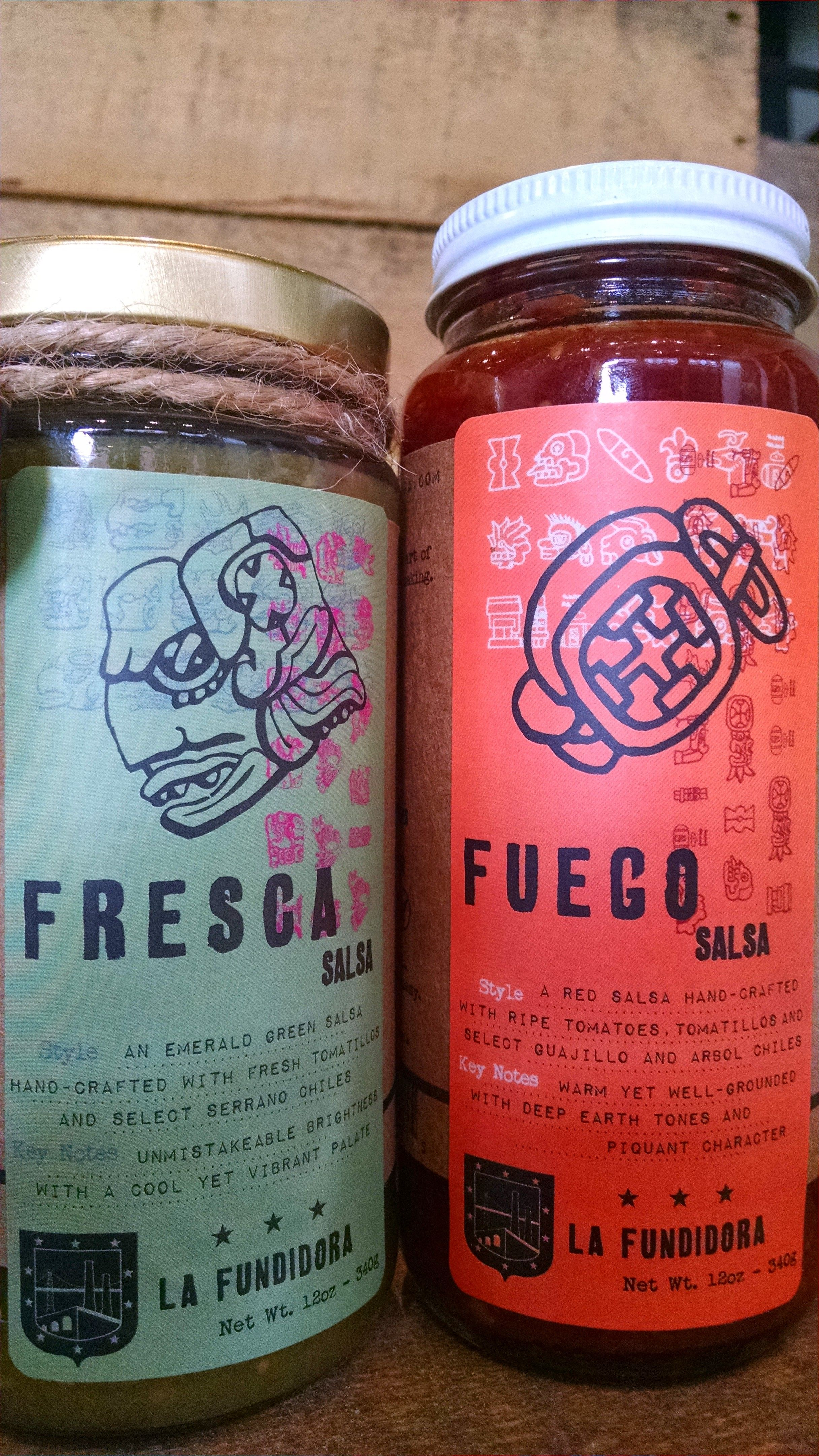 Sometimes radically different looks fit into one consistent brand look, like these salsas from La Fundidora. Consistent motifs, communication and design style clearly set these two jars apart.