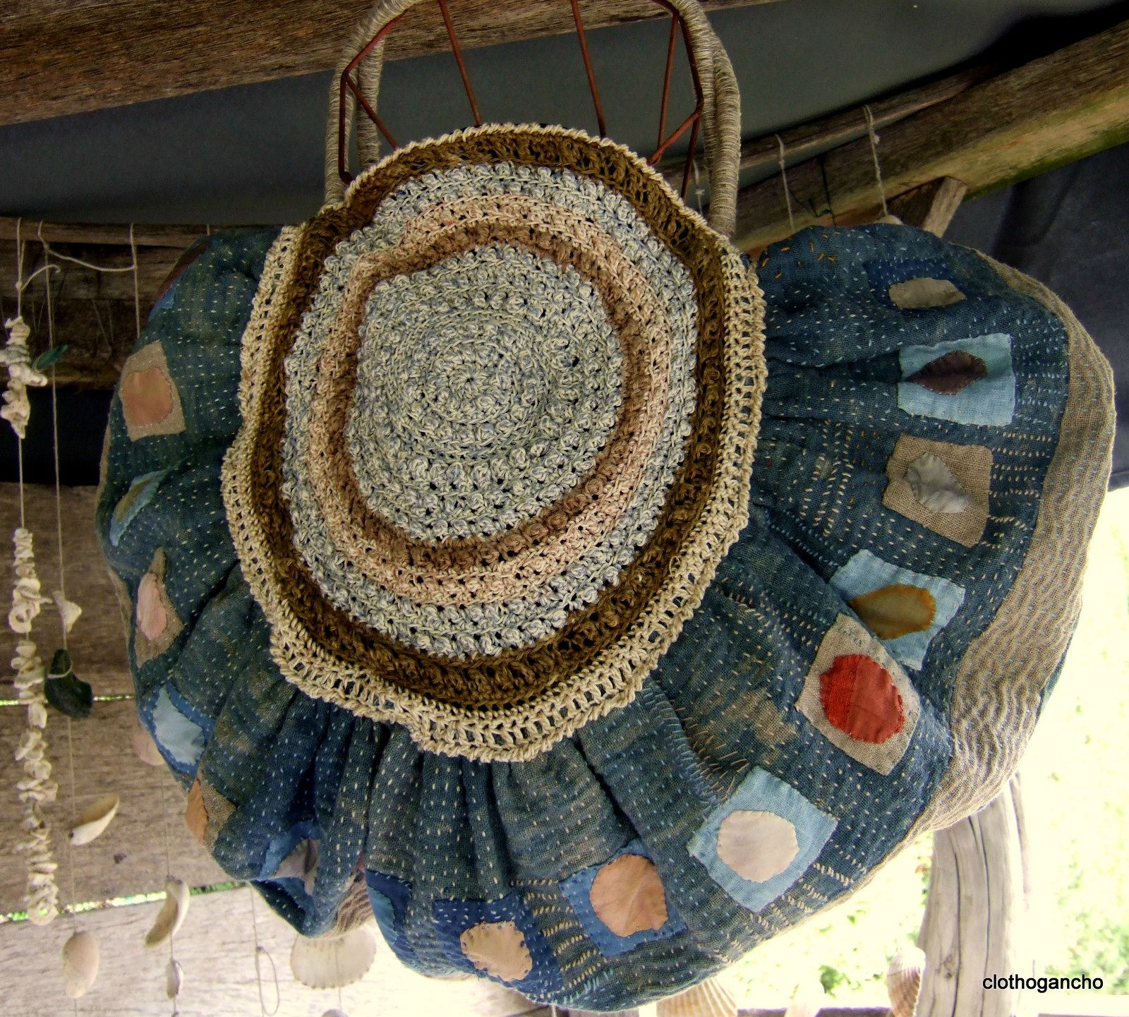 This resembles the purse you bought in Aspen age 14....love the combination of repurposed embroidered fabric (I'm assuming) and crochet. I would reinforce the circle with cardboard (essentially a pocket so you can take the cardboard out to wash) and probably make it smaller.