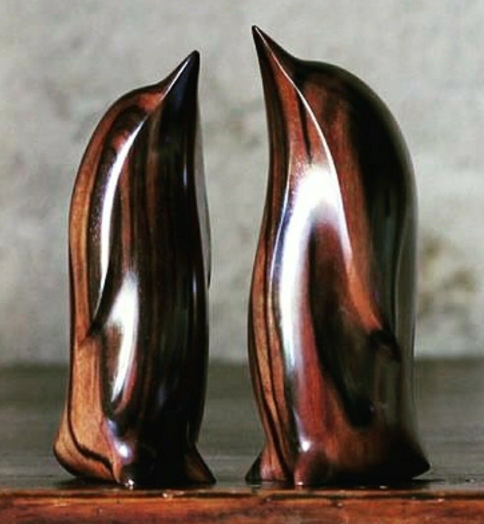 Two handcarved penguins carved stylized pinterest carving