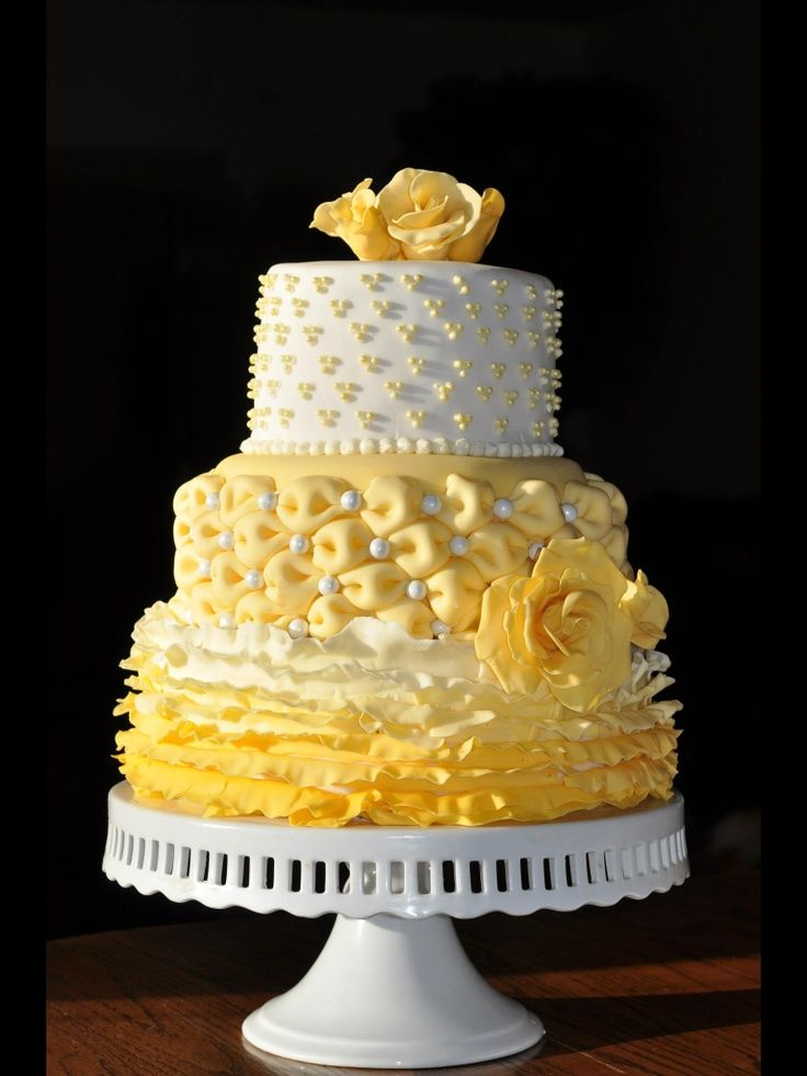 The cake is topped with a striped hat with a hand molded brim ...