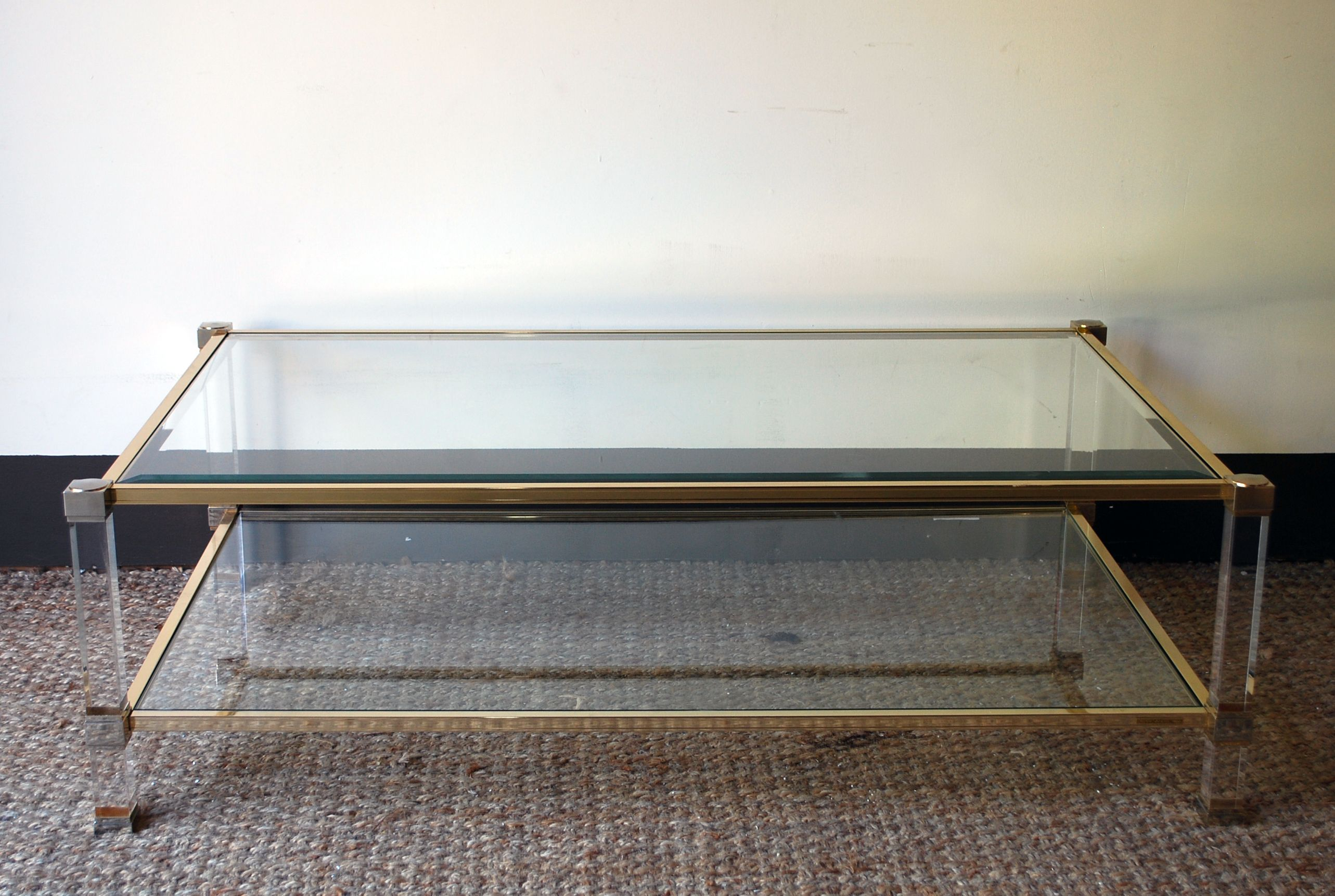 Brass and glass coffee table with lucite c 1920 imported from