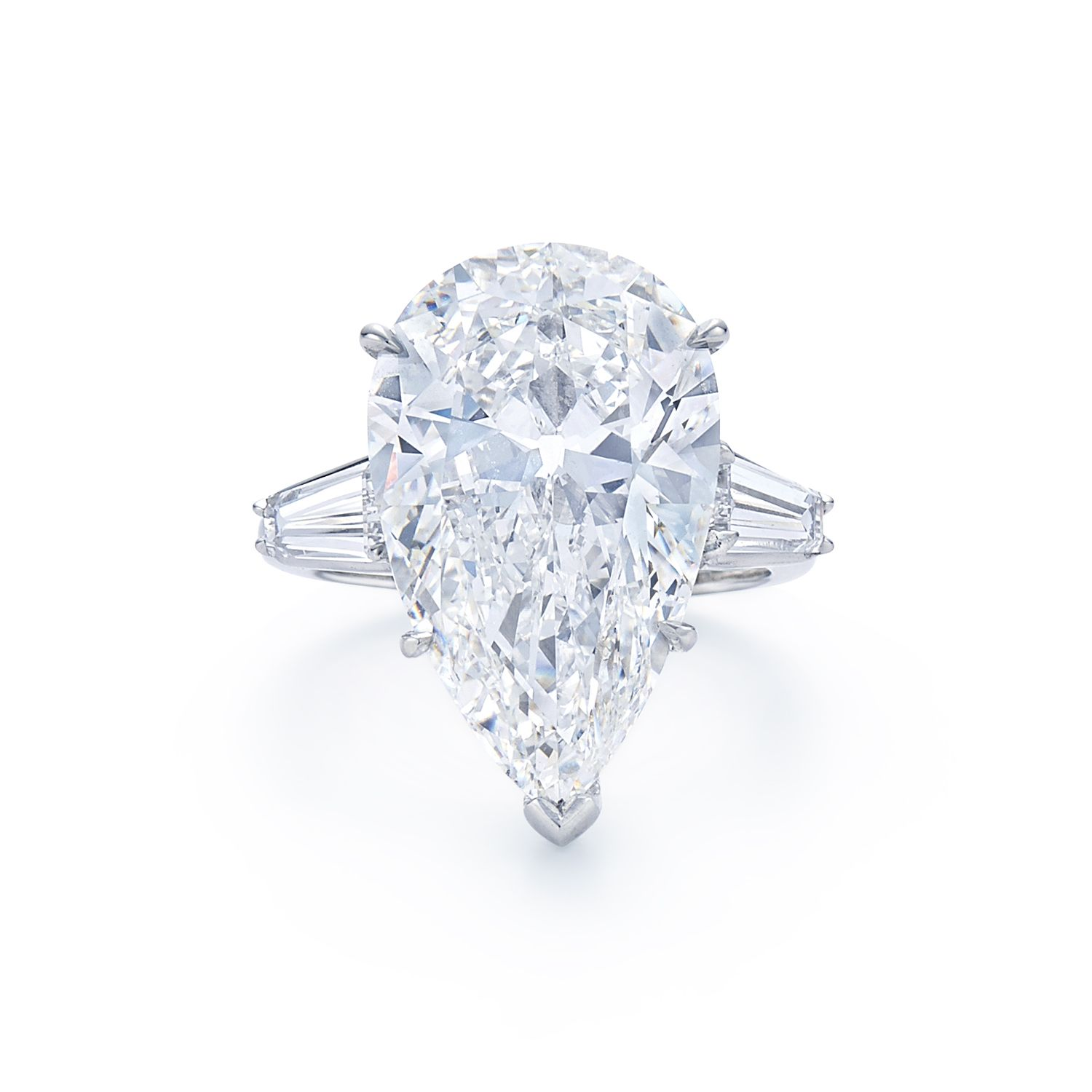 Pear shape diamond ring with tapered baguette side stones Set in