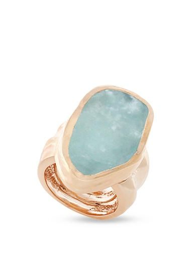 An eye-catching aqua stone accent beautifully complements this ring's shining rose gold-hued metal.