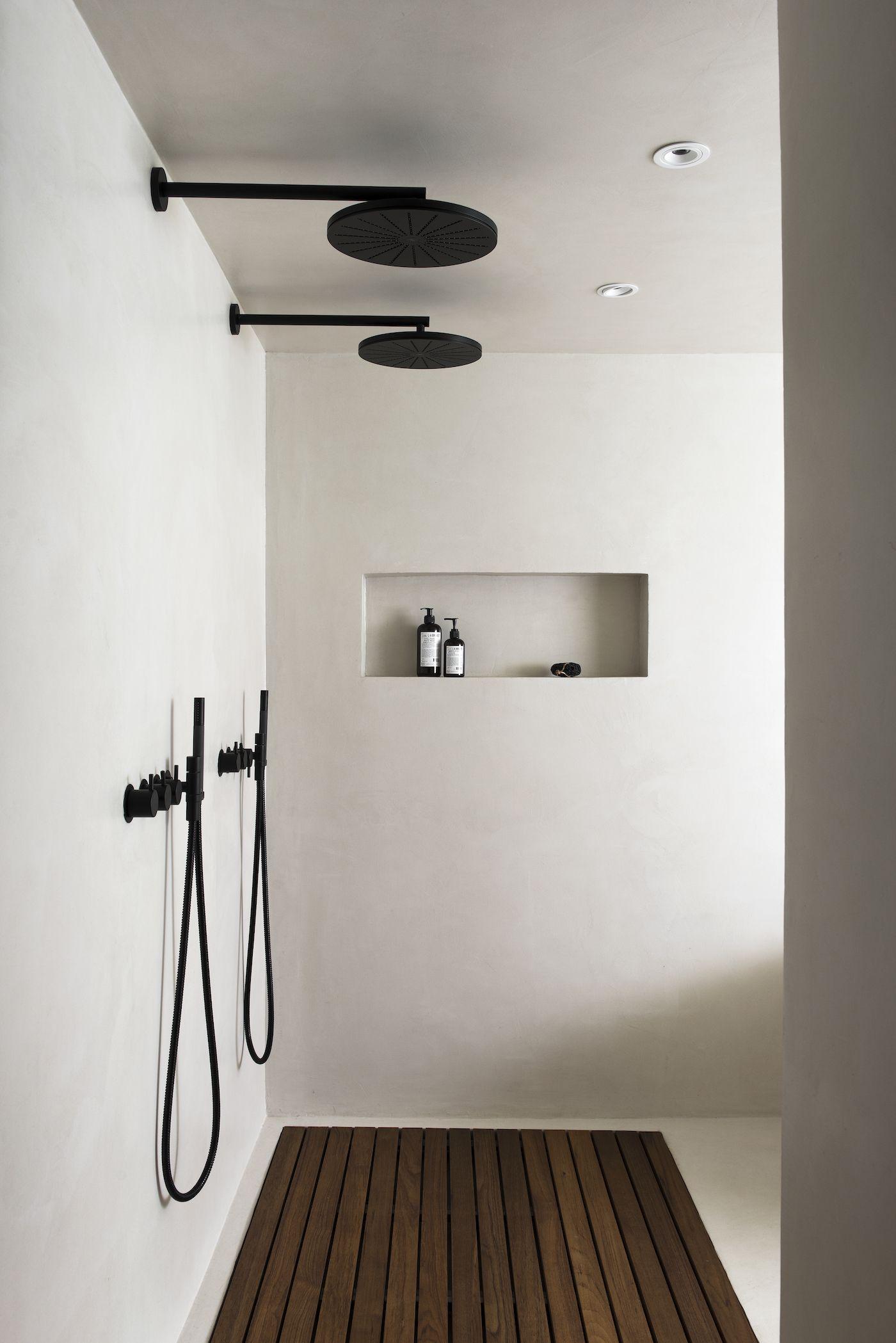 VOLA 060 round head shower in black. Interior design by Laura Seppanen. Black and white bathroom. #blackshowerhead #blacktapware #blackwhitebathrooms