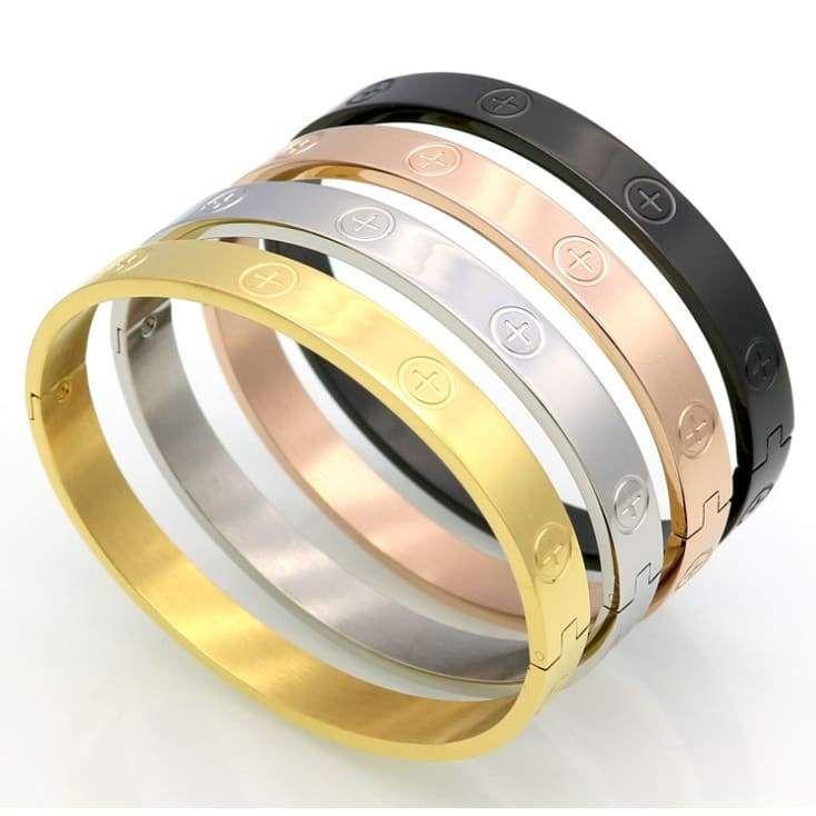 Stainless steel bracelet with cross & circle engraving. Weight: 23g Bracelet: width 6mm, inner diameter 4.9cm, outer diameter 5.9cm