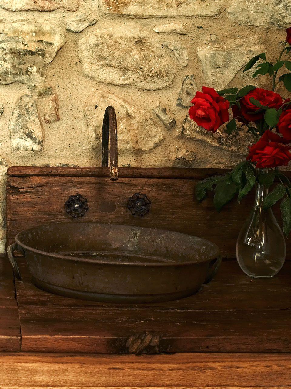 bathroom sink with a metal pan