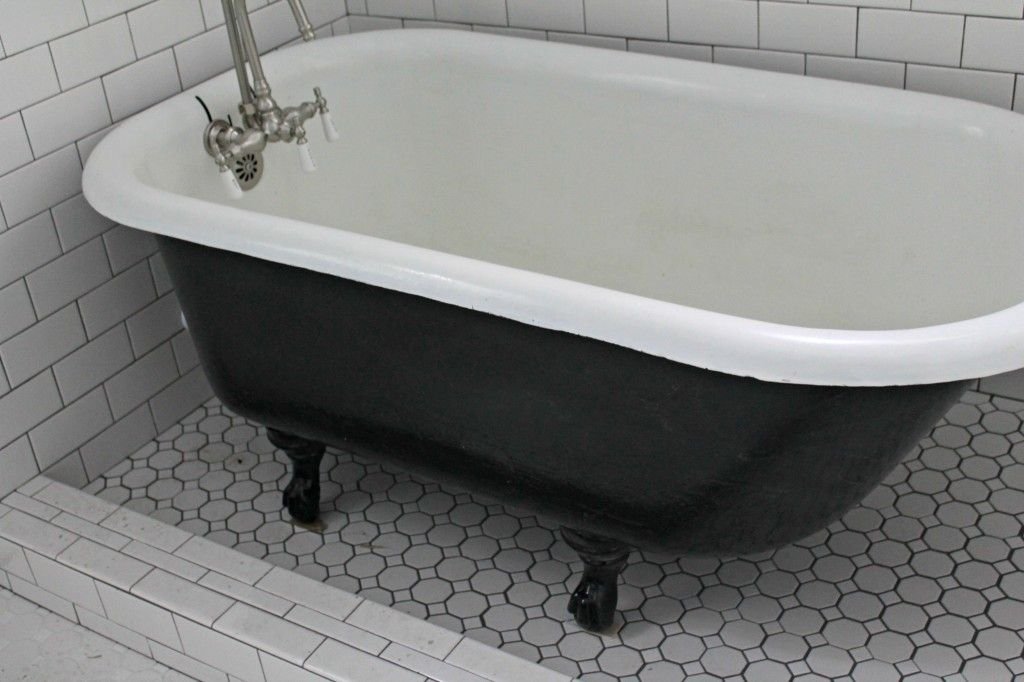 Freestanding Clawfoot Tub Inside A Curbed Shower Stall