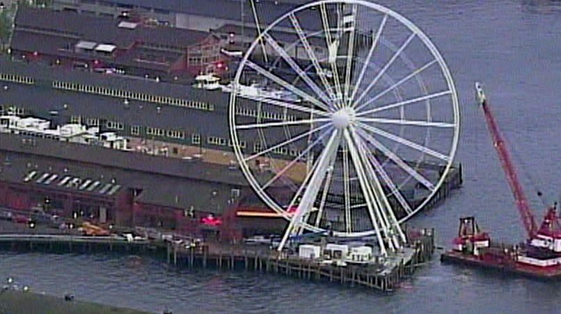The Seattle Great Wheel, a huge Ferris wheel on Seattle's waterfront, is under construction.
