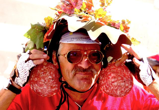 Crazy Biker With Salami Earrings: All the bikers came up the hill and stopped for a drink of Wine and slices of meat. This guy was a crazy participant who was most entertaining! #travel #silly #italy #tuscany #florence